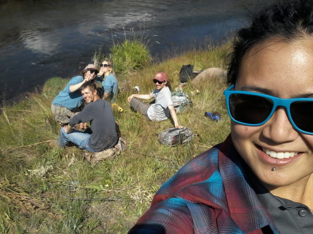 Volunteer group selfie by a river